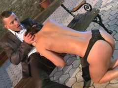 Hot brunette Claudia Rossi fucks on the street bench