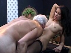 Young brunette stimulated by old cock
