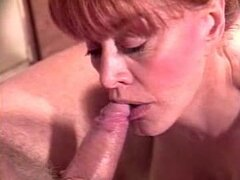 Redhead mature with incredible tits sucks her lovers cock