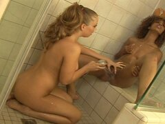 Sexy lesbians playing in the bathroom