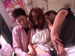 Asian redhead enjoying a nasty threesome on a bus