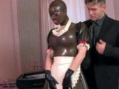 Sub dressed in latex French maid outfit