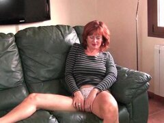 Redheaded mature mom plays with her nipples...