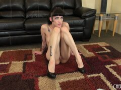 Skinny brunette Asphyxia Noir is on the floor and playing with herself