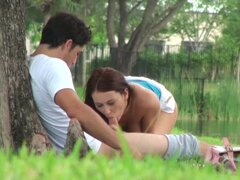 Curly brunette Alexis Grace fucks in her snatch in the park
