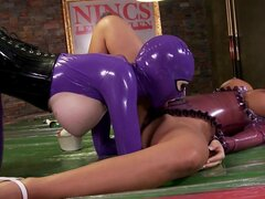 Latex babes Black Angelica and Latex Lucy licking each other pussies