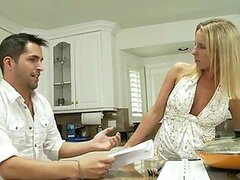 Guy fucks his sexy blonde stepmother in the kitchen