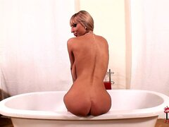 Gorgeous milf shows off her big natural tits, lovely ass and shaved cunt in the bathtub