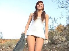 Alaura Shows Her Round Ass In AN Outdoors Scene