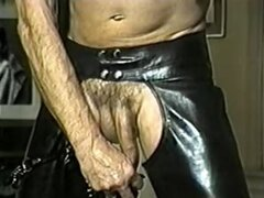 Leather clad old guy in chains masturbates