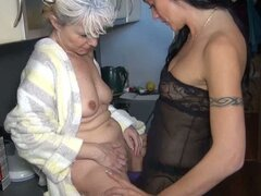 Granny gets pounded by a milf while she does the dishes