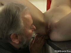 Katia lets the old guy suck her bald wet pussy in the kitchen