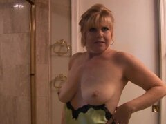Mature babe Dawn Jilling is taking nice hot shower