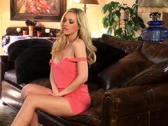 Famished blonde licks her fingers and slowly pulls her pink dress down