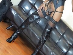 shemale escort in boots with dildo up asshole