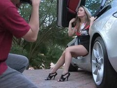 Tight dressed girl doesn't waste time while her car is broken.