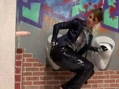 Movie showing a glamorous girl playing with a bukkake toy at a restroom gloryhole