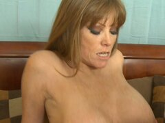 Hot blonde cougar Darla Crane with saggy tits blows and fucks young dick