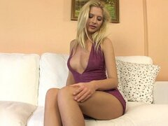 A gorgeous blonde babe takes her sexy dress off and gives an epic solo show