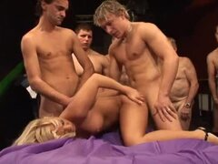 Sexy blonde chick getting fucked hard by 50 horny guys