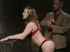 A sexy redhead in some hot red lingerie gets tied up and treated like a pet.