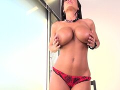 Hot brunette Milf Lisa Ann strips and poses before fingering her snatch