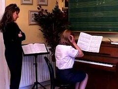 Piano teacher spanks her student hard