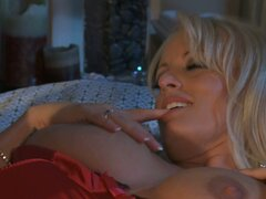 Sexy milf Stormy Daniels looks great in red silk corset