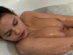 Eve Angel taking bath and masturbating her pussy