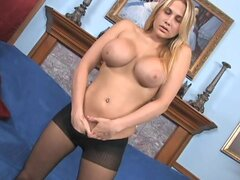 Spicy blonde in stockings is demonstrating her natural big tits