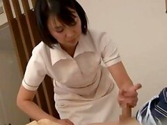 Stunning Japanese masseuse is having wild sex on a bed