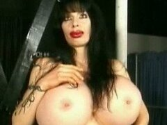 Bizarre Dominatrix Mistress Rhiannon Shows Her Gigantic Monster Boobs