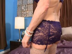 A gorgeous granny has her luscious lingerie on to play with herself...
