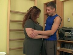 Busty fat brunette drilled by hunk trainer