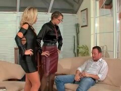 Mistress instructs slut in a dress to suck a dick