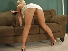 Delicious blonde model taking off her pantyhose