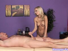 Young blonde babe giving a handjob to her lucky costumer after a massage