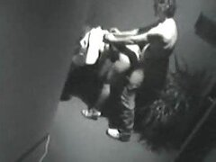 Security cam in the office corridor filming fuck session
