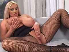 Blonde with shaved pussy Laura Orsolya is masturbating
