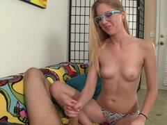 Nerdy teen wearing glasses gives handjob till this guy cums