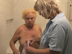 Nurse washes down old blonde granny