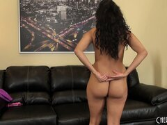 Gia Steel puts her legs behind her head during a nude solo show