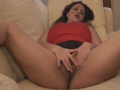 Busty mature brunette in mini skirt panty plays