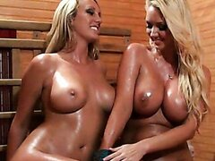 Two gorgeous and busty blondes go at it in this incredible lesbian scene.