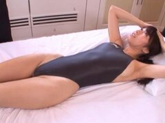 Alice Miyuki takes two at a time in her swimsuit