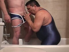 Two gay wrestlers do a golden shower and then suck cock