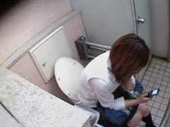 Schoolgirl talks to her bf and masturbates on toilet spy cam