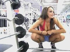 Brunette Teal is showing her sexy body in gym
