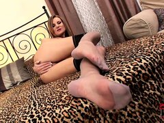 She fingers her cootch, plays with her feet and toys her wet cunt
