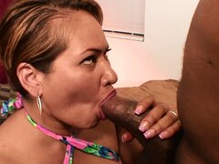 Stacked Latina milf with a big round ass has a big black cock satisfying her needs